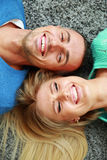 Young couple lying on the carpet Royalty Free Stock Photos