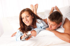 Young couple lying down in lounge Stock Photo