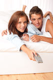 Young couple lying down in lounge Royalty Free Stock Photos