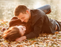 Young couple lying down smiling Stock Photography