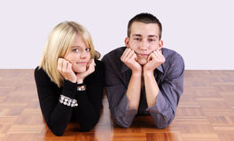Young couple lying on the floor Royalty Free Stock Image