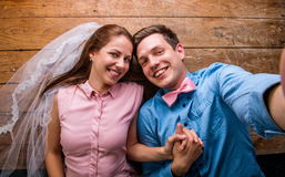 Young couple lying on a floor against wooden background Stock Photography