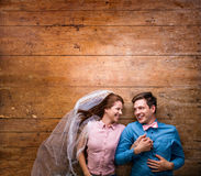 Young couple lying on a floor against wooden background Royalty Free Stock Image