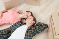 Young couple lying on the floor Stock Photography