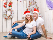Young couple lying on the floor of decorated christmas room Stock Photo