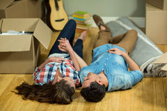 Young couple lying on floor in their new house Royalty Free Stock Photos