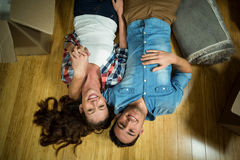 Young couple lying on floor in their new house Royalty Free Stock Photography