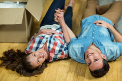 Young couple lying on floor in their new house Stock Photography