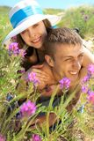 Young couple lying on grass Royalty Free Stock Photography