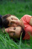 Young couple lying in grass. Young couple lying in green grass Stock Photos