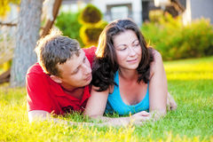 Young couple lying on the grass Royalty Free Stock Image
