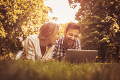 Young couple lying on the grass. Stock Photography