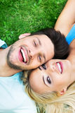 Young couple lying in grass Royalty Free Stock Images