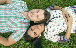 Young couple lying on grass Stock Photography