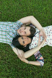Young couple lying on grass Stock Images