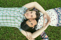 Young couple lying on grass Royalty Free Stock Photos