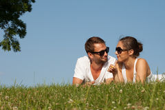 Young couple lying on the grass Royalty Free Stock Images