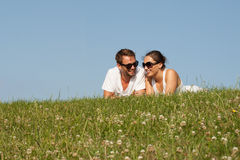 Young couple lying on the grass Stock Image