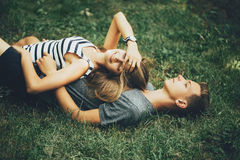Young couple lying on the grass. On sunny day Stock Image