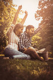 Young couple lying on the grass. Royalty Free Stock Images
