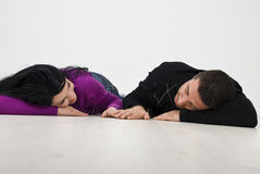 Young couple lying and holding hands Royalty Free Stock Photography