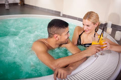 Young couple lying in jacuzzi,concept of romantic love Royalty Free Stock Photo