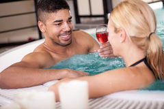 Young couple lying in jacuzzi,concept of romantic love Stock Images