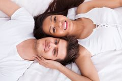 Young couple lying on mattress Stock Photo