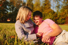 Young couple lying on a meadow Royalty Free Stock Photography