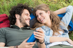 Young Couple Lying On Meadow Stock Photography