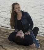 Young couple lying on the night beach Stock Image