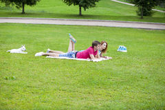 Young couple lying in the park on a summer day Royalty Free Stock Photo
