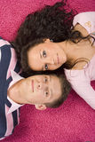 Young couple lying on the pink carpet Stock Photography