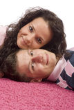 Young couple lying on the pink carpet Royalty Free Stock Images