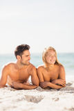 Young couple lying on sand Royalty Free Stock Photo