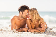 Young couple lying on sand Royalty Free Stock Images