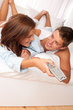 Young couple lying on sofa Stock Image