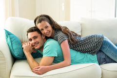 Young couple lying on sofa Royalty Free Stock Photos