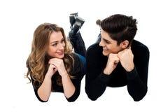 Young couple lying on the studio floor Stock Photo