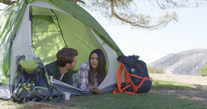 Young couple lying in tent Royalty Free Stock Image