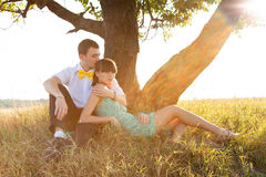 Young couple lying under the tree Royalty Free Stock Photo