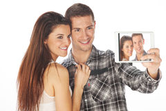 Happy couple makes self-photo on the notebook Stock Photography