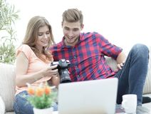 Young couple makes viewing photos in photo camera Stock Photo