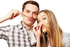 Young couple making fake moustache from hair Royalty Free Stock Images
