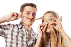 Young couple making fake moustache from hair Stock Photos
