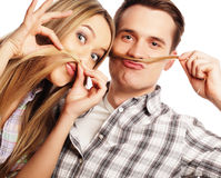 Young couple making fake moustache from hair Royalty Free Stock Photo