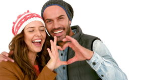 Young couple making heart with hands. Against white background stock video footage