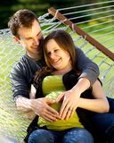 Young Couple Making Heart On Her Pregnant Belly Stock Photo