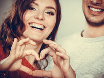 Young couple making heart shape by hands Royalty Free Stock Image