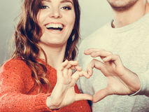 Young couple making heart shape by hands Royalty Free Stock Photo